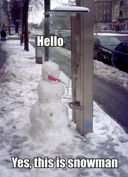Snowman Uses A Payphone
