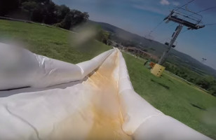 A First Person POV Video Of The World's Longest Slip N Slide