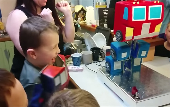 An Optimus Prime Cake That Really Does Transform & Roll Out