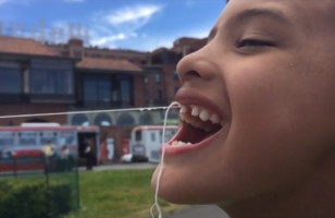 Watch A Little Boy Get His Tooth Pulled By A Drone