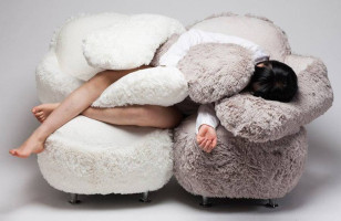 The Free Hug Sofa Has Two Arms To Wrap Around You
