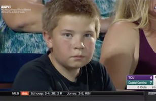 This Kid Has A Stare Down With A Camera At A Baseball Game