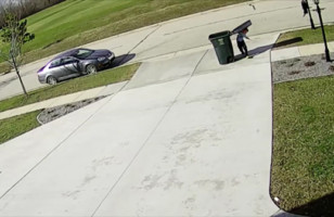 Watch This Kid Try To Take Out The Garbage On A Windy Day…