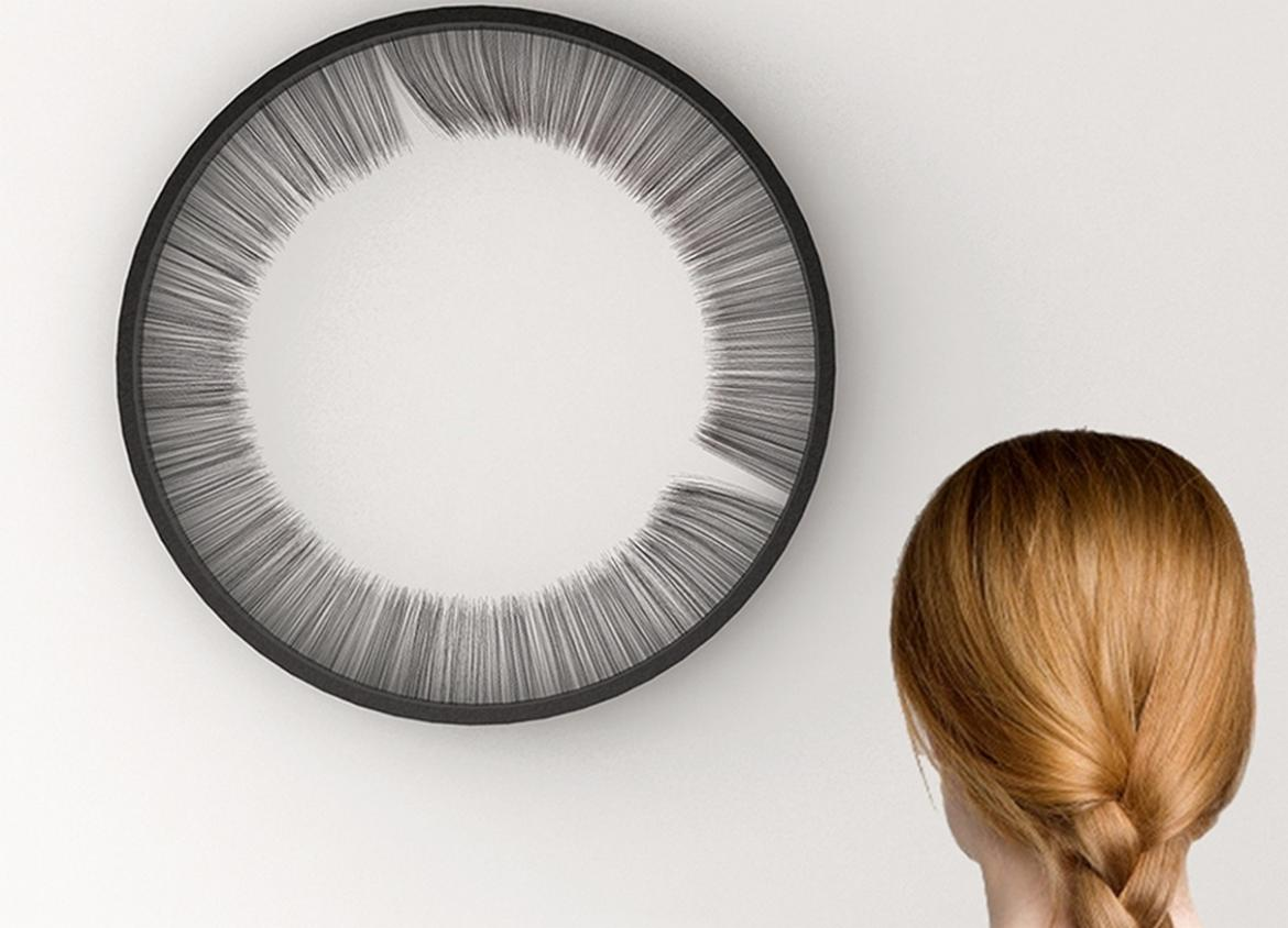 So Here's A Weird Clock That Tells Time Using Hair...