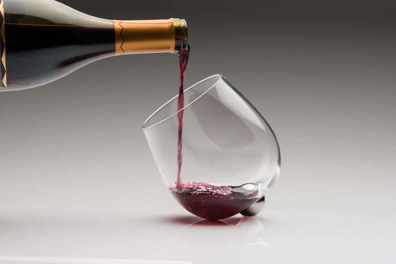 The Aura Glass Rotates To Prevent Spills And Aerate Your Hooch