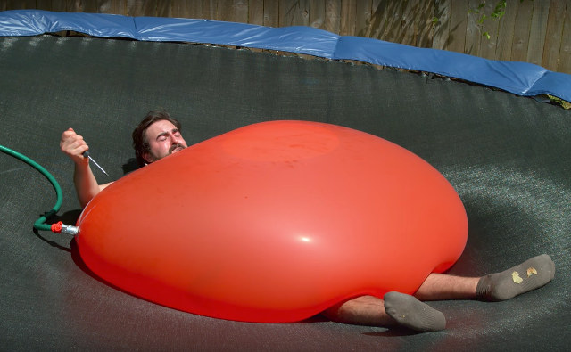 Watch This Guy Pop A Giant Water Balloon On Himself In Slo-Motion