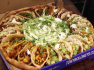 The Taco Tuesday Pizza Is Topped With Tacos And Guacamole