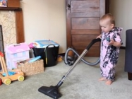 A Dad Demonstrates How To Get A Baby To Clean The House
