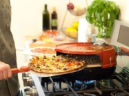 This Stove Top Pizza Oven Cooks Your Pizza In 6 Minutes
