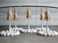 The Rocket Coffee Table Is Held Up By Mini Rocket Ships!