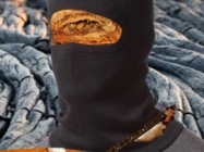 Baklava Wearing A Balaclava Playing A Balalaika On Black Lava