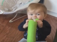 Watch As This Baby Realizes He's Chewing On A Dog Toy