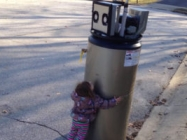 A Little Girl Thinks A Water Heater Is A Robot And It's Too Cute