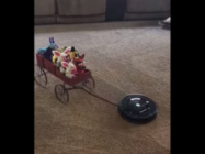 Watch A Roomba Take A Wagon Full Of Toys For A Ride